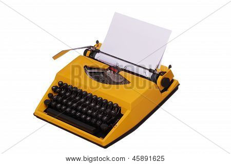 Yellow Typewriter With Paper