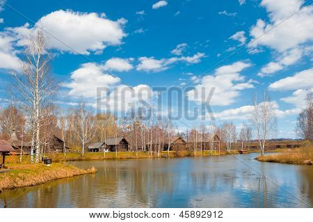 Rural landscape with a pond in the Russian village