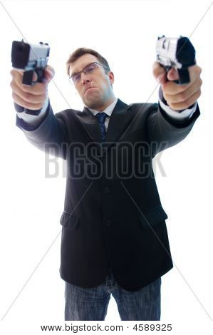 Angry Criminal Businessman With Two Aimed Guns
