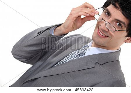 Businessman removing glasses