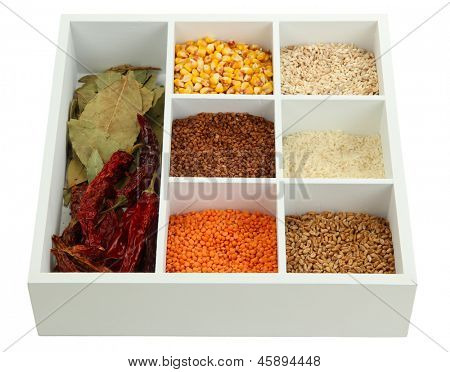 Assortment of cereals in white wooden box isolated on white