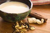 stock photo of darjeeling  - masala chai with milk and ingredients - JPG