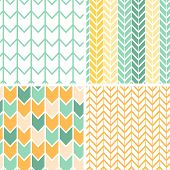 stock photo of chevron  - Vector set of four gray and yellow chevron patterns and backgrounds - JPG