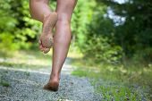 Woman's Feet Running On Gravel Road
