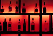 image of wine-glass  - Back lit bottles in a cocktail bar - JPG