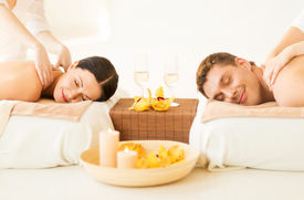 stock photo of all-inclusive  - picture of couple in spa salon getting massage - JPG