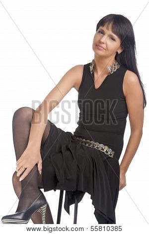 Portrait Of Relaxing Brubette Woman On High Chair