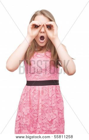 Portrait Of Caucasian Teenage Girl Immitating Binocular Using Hands