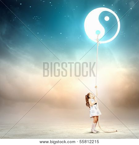 Image of little girl in white dress pulling rope with dao symbol