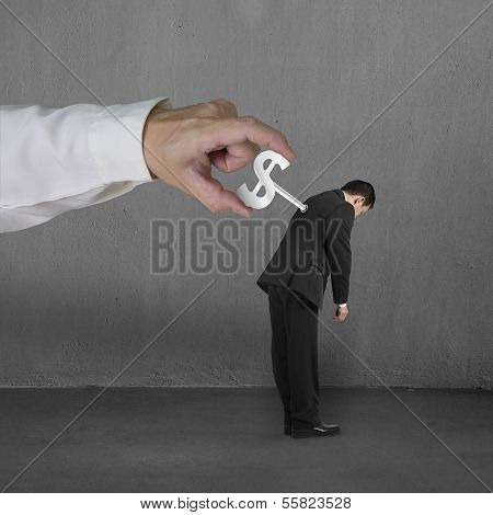Hand Windering Winder On Businessman's Back, Concrete Background