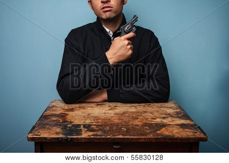 Thug At Table With Gun