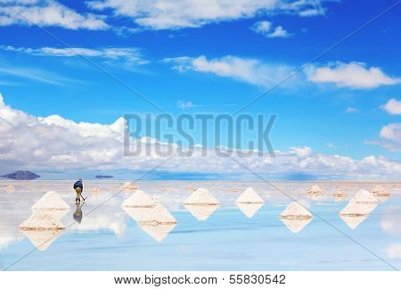 Worker performing harvesting salt