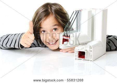 Cute boy with plastic pvc window profile