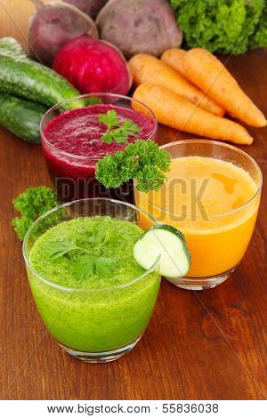 Fresh vegetable juices on table close-up