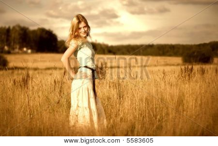 Beautyful Woman In Summer Field