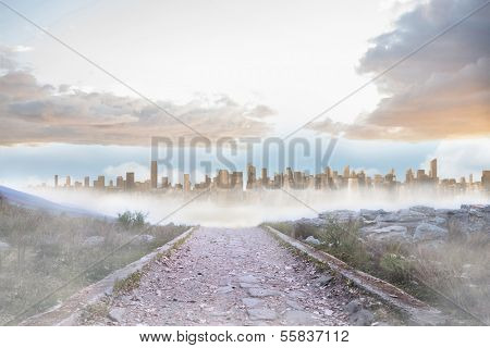 Rocky path leading to large urban sprawl