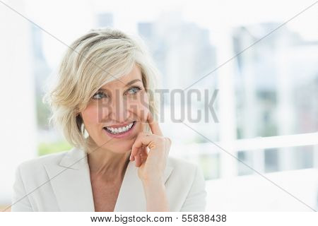 Close-up of a mature businesswoman looking away in a bright office