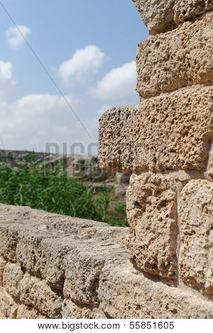 Ancient weathered stone wall in Nahal Taninim archeological park in Israel