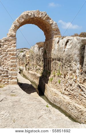 Ancient irrigation ditch and arch in Nahal Taninim archeological park in Israel