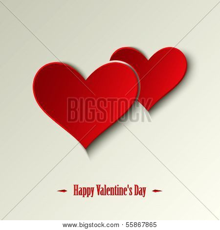 Valentine card with red hearts on a light background