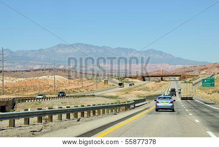 Cars On A Desert Road