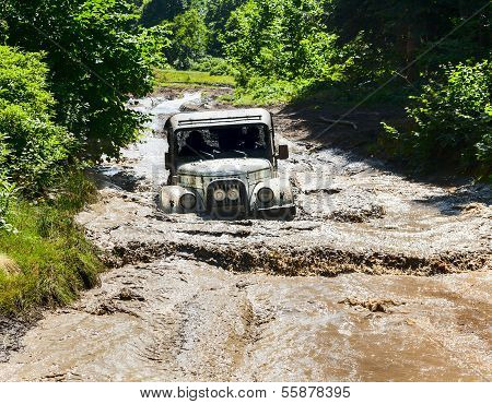 Off road Vehicle UAZ at speed on difficult road