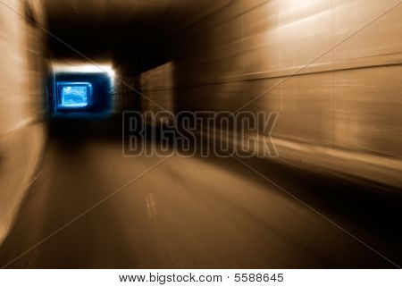 Tunnel With Weak Light In Motion