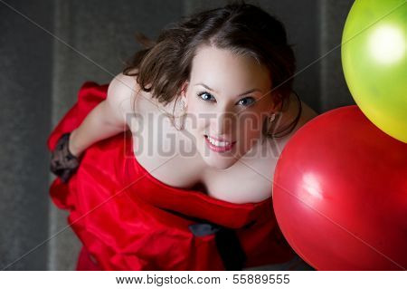 A Beautiful And Happy Young Girl With Balloons