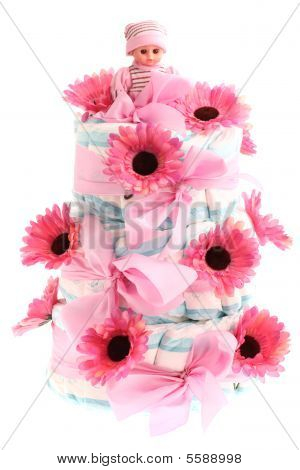 Pink three-tier diaper birthday cake isolated on white