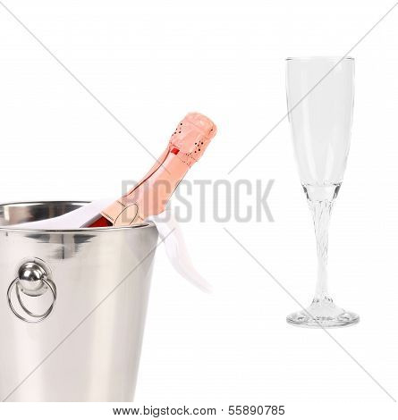 Champagne bottle in cooler and glass