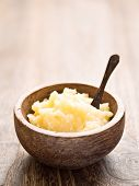 stock photo of ghee  - close up of a bowl of indian ghee - JPG