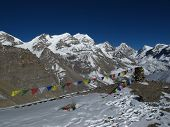 High mountains and prayer flags in Nepal