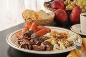 stock photo of pot roast  - Slow roasted pot roast with potatoes and carrots - JPG