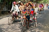 DHAKA, BANGLADESH - SEPTEMBER 17, 2009: Traditionally ornamented cycle rickshaws presents a very pra
