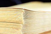 stock photo of manila paper  - Stack of yellow manila envelopes closeup background - JPG