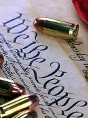 pic of bill-of-rights  - US Constitution Bill of Rights with 45 caliber bullets and American flag - JPG