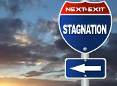 pic of stagnation  - Stagnation road sign with nature sky view - JPG