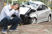 stock photo of sadness  - Upset driver After Traffic Accident - JPG