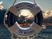 image of ship  - view on the sailing ships in sunset through blue safe belt with welcome on board sign - JPG