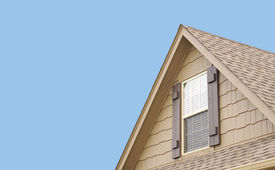 picture of red siding  - Roof gable with blue sky and window shutters - JPG