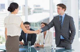 stock photo of half-dressed  - Handshake to seal a deal after a job recruitment meeting in an office - JPG