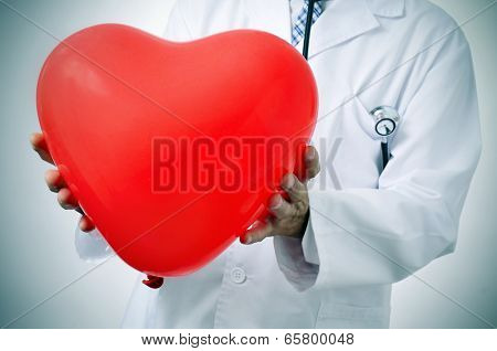 a doctor holding a red heart-shaped balloon, symbolizing the cardiovascular medicine