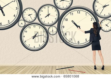 Asian business woman repair the clock, concept of time management, rebuild, busy etc.