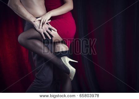 Sexy loving couple embrace.