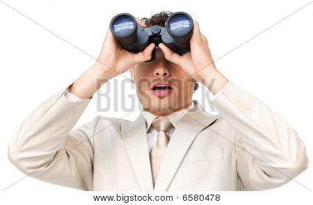 Surprised Businessman Looking Through Binoculars