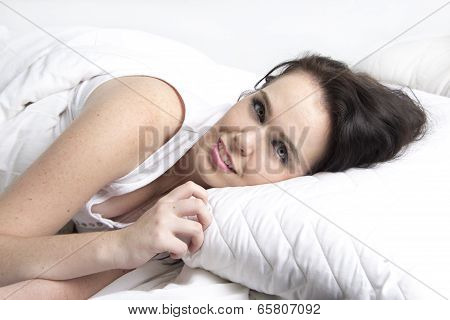 sexy young model under warm white duvet