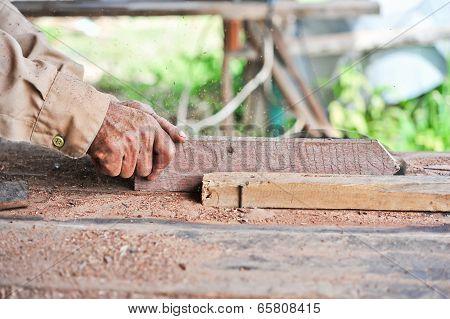 Carpenter Working With Circular Saw Blade