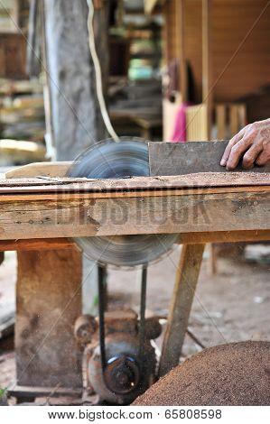 Carpenter Working On Woodworking Machines