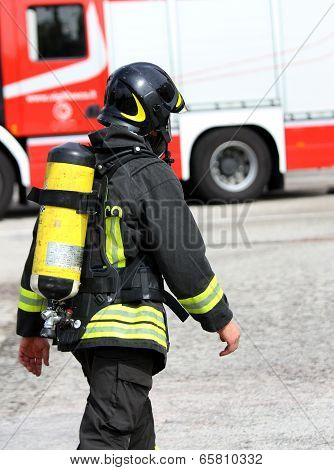 Italian Firefighter With The Oxygen Cylinder And The Helmet