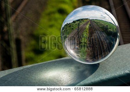 crystal ball with train tracks